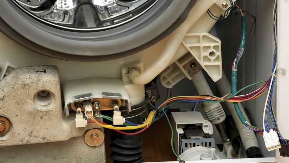 naprawa pralki kraków widok dolnej części bębna pralki wymiana amortyzatorów w pralce